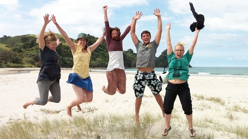 small group jumping at the beach in New Zealand