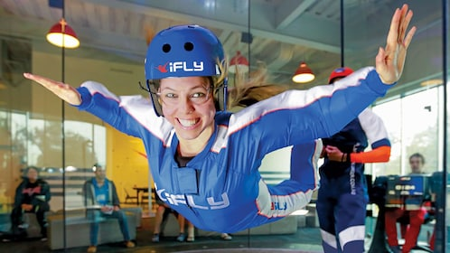 Woman skydiving at iFLY facility