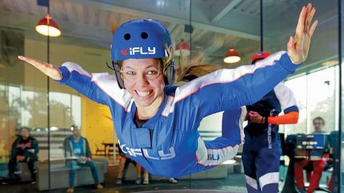 Woman skydiving at iFLY facility