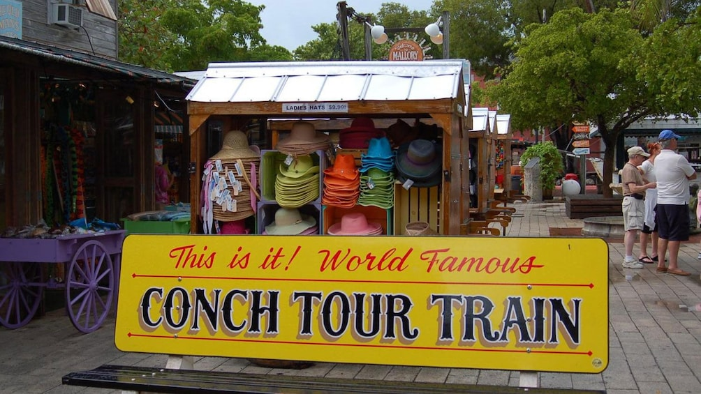 Show item 2 of 8. Bench with a sign for the Conch Tour train in Key West