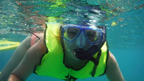 woman snorkeling in the water in Aruba