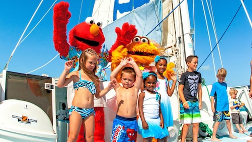 Kids and Sesame Street characters on the Sesame Sail Away Catamaran Cruise in the Turks and Caicos Islands
