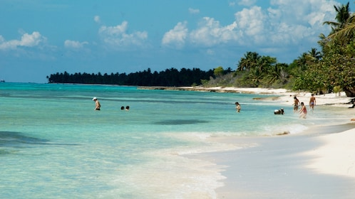 Tourists swimming on Saona Island