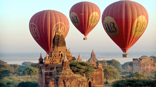 Stunning view of three hot air balloons floating over Bagan