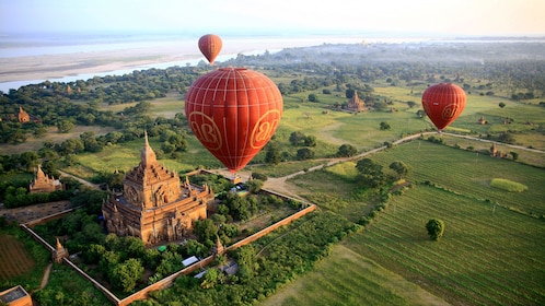 Breathtaking view of hot air balloons floating over Bagan