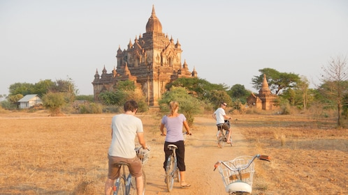 biking on a trail near a temple in Bagan