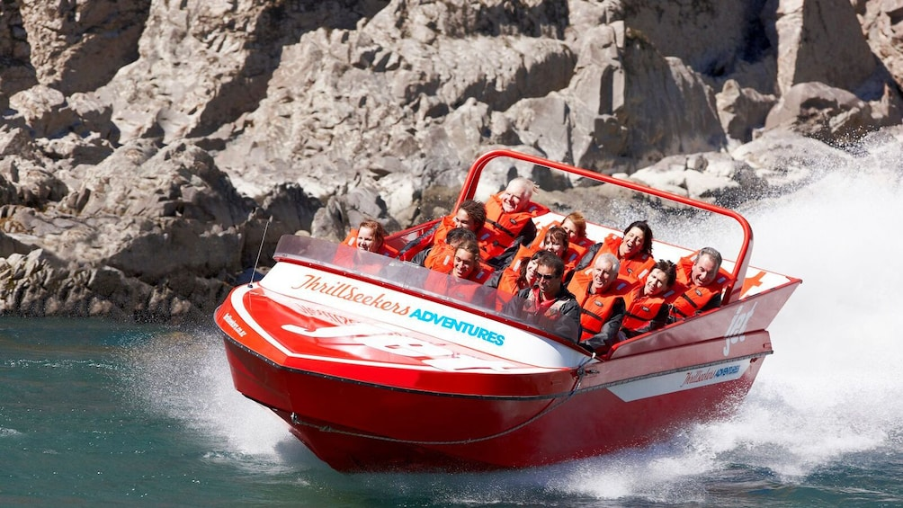 Show item 1 of 4. Tour group enjoying the Jet Boating Ride on the Waiau River in Christchurch