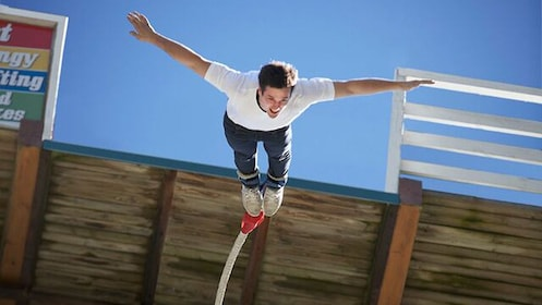 Close view of a man Bungee Jumping at Hanmer Springs
