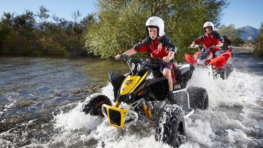 Show item 3 of 5. Two people on the 4x4 Quad Bike Tour in Hanmer Springs