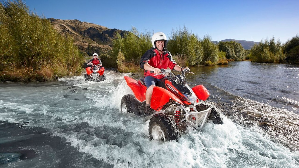 Show item 1 of 5. Guests enjoying the 4x4 Quad Bike Tour in Hanmer Springs