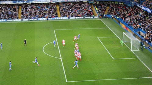 View of match in goal during London Chelsea Football Match at Stamford Bridge Stadium