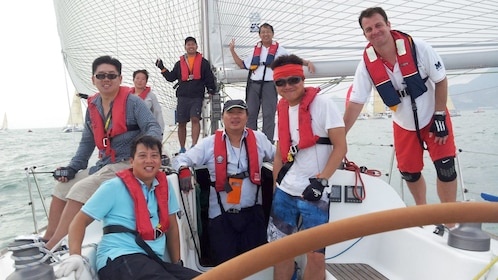 Group photo of tourists aboard the catamaran in Hong Kong