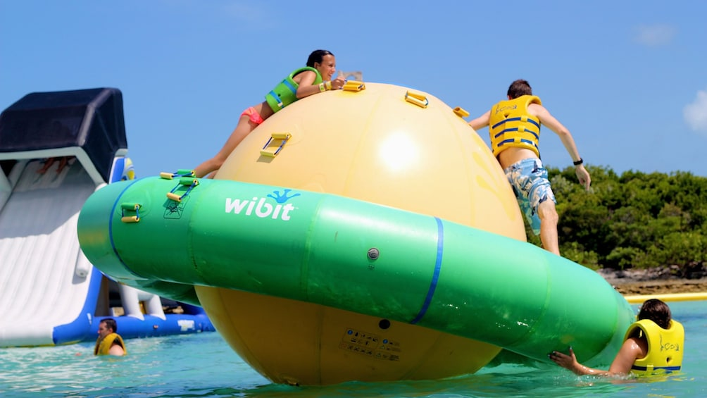 Kids frolic on a huge WiBit inflatable ball