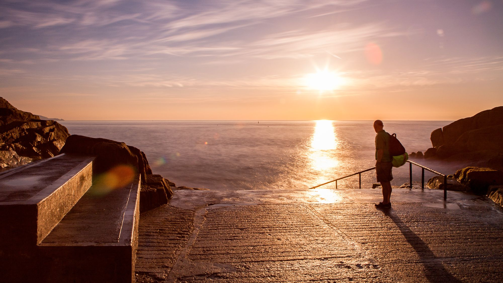 Beautiful sunset view of a tourist near the waters of Dublin on a clear day