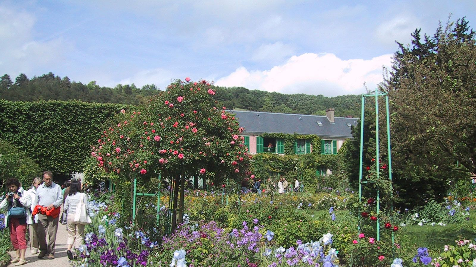 Tourists explore the gardens of Giverny Village