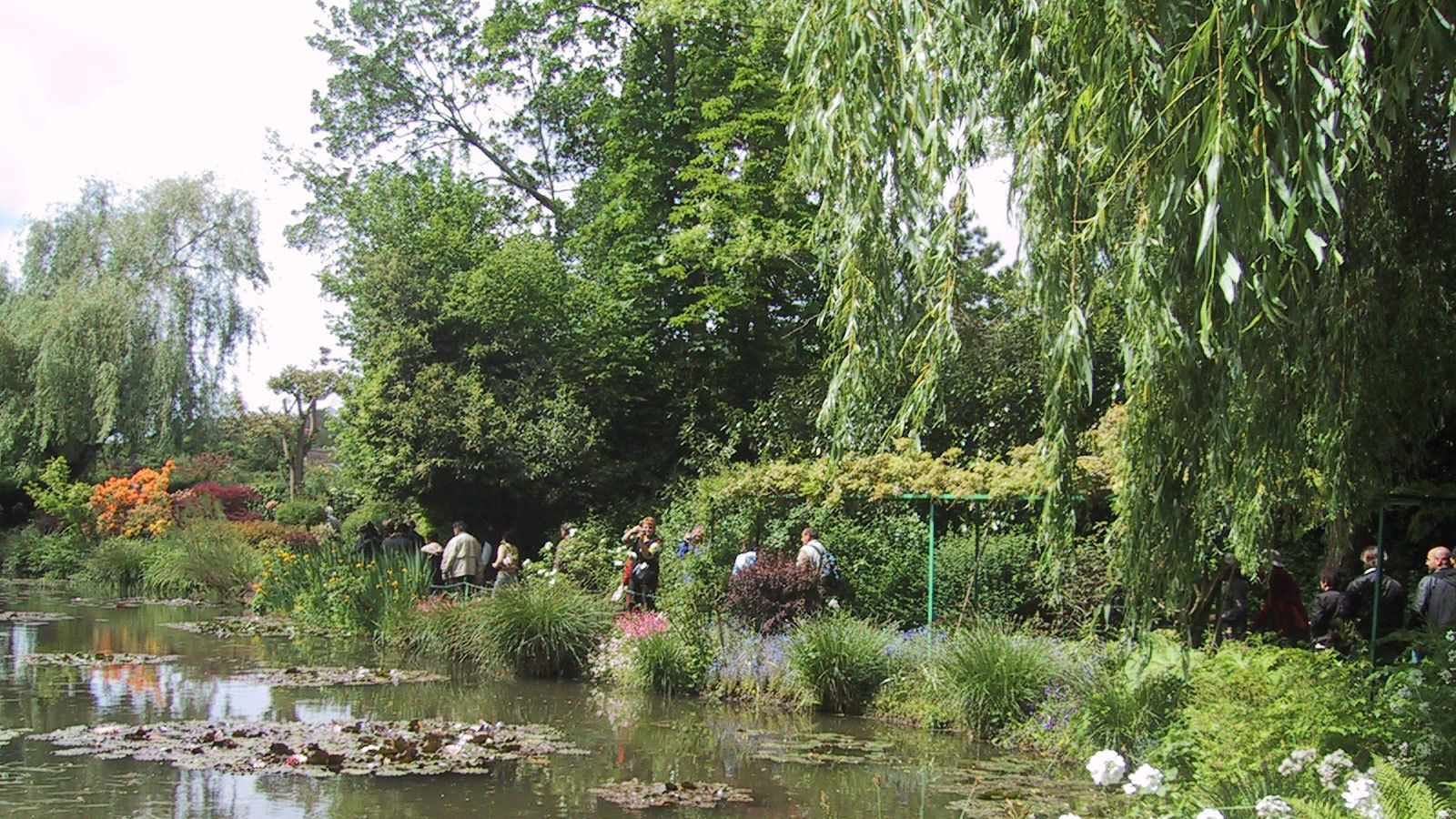 Guests pass a nearby pond within Giverny Village
