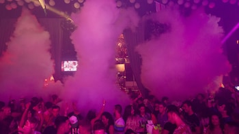Show item 5 of 5. Dry ice smoke billows out onto the dance floor at Mandala