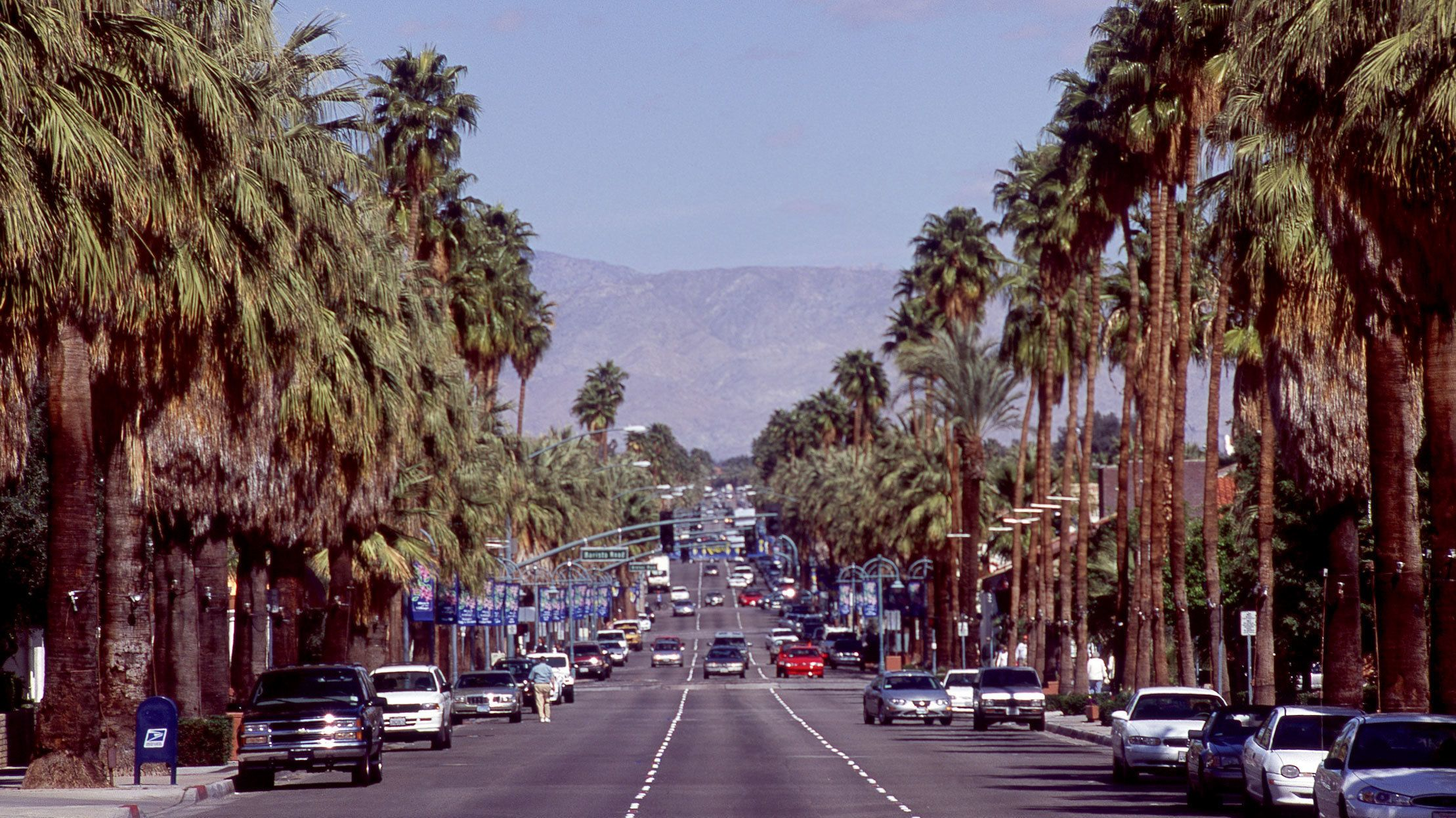 Palm trees line a busy street in Palm Springs