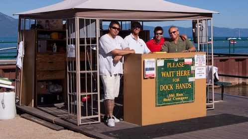 Dock hands hanging out at the booth in Lake Tahoe