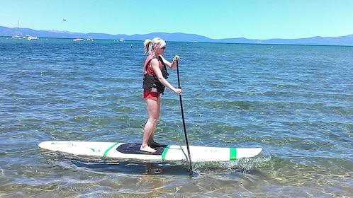 Woman paddle boarding in Lake Tahoe