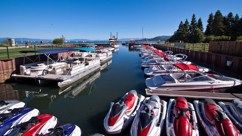 Jet skis and boats docked at the bay in Lake Tahoe