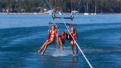 Parasailing women descending into the water in Lake Tahoe