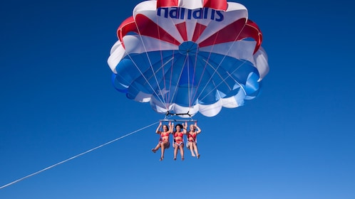 Parasailing women high in the air in Lake Tahoe