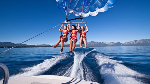Women taking off in their parasail at Lake Tahoe