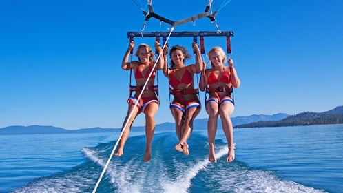 Women parasailing close to the boat in Lake tahoe