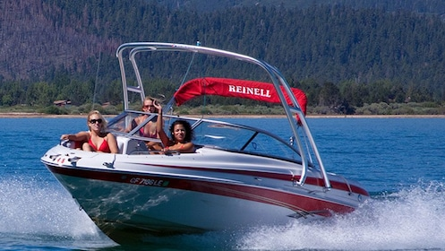 Women on a speeding rental boat in Lake Tahoe