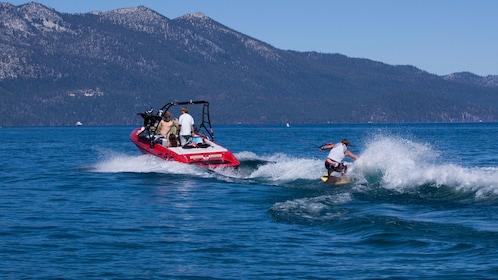Man wake boarding behind a speedboat in Lake Tahoe