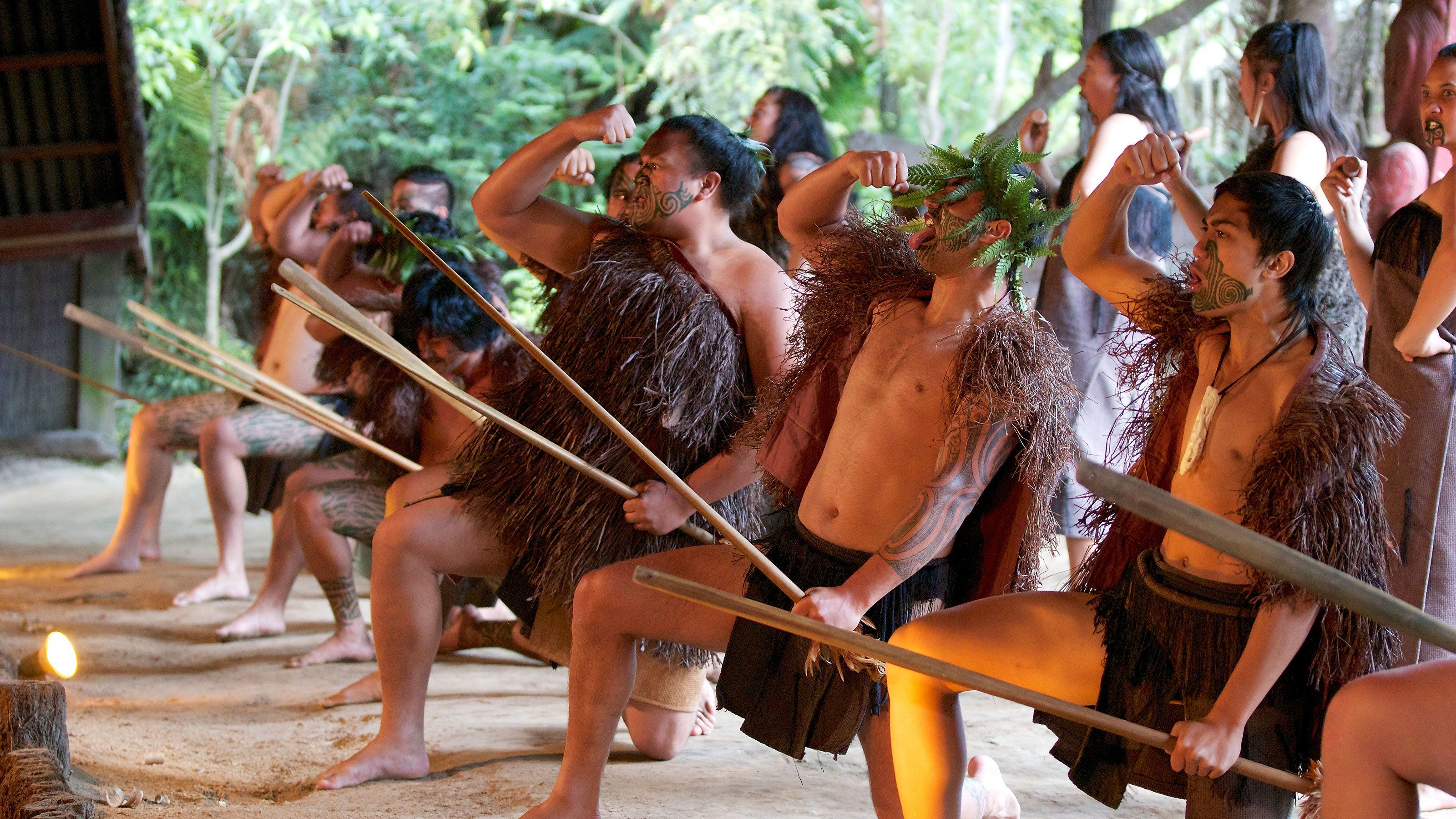 tribesmen performing ritual dance in New Zealand