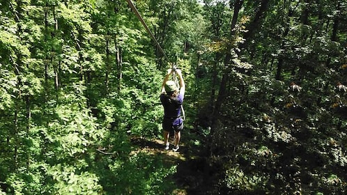 woman ziplining through the woods in Indiana