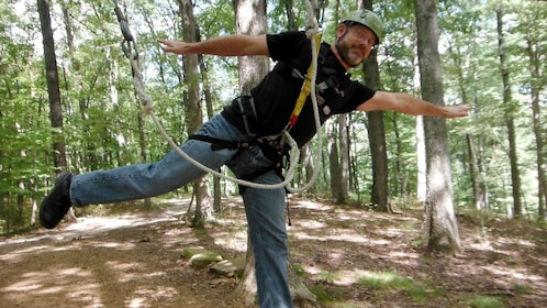 Man strapped into ziplining gear in Indiana