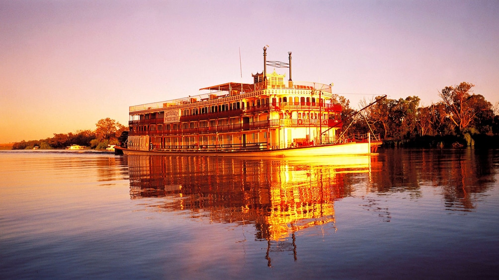 Show item 1 of 5. Boat on the waters of the Murray River Wetlands at sunset in South Australia