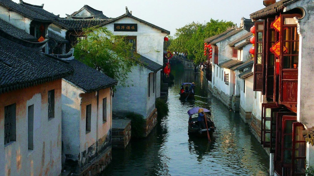canal lined with buildings in Suzhou, China