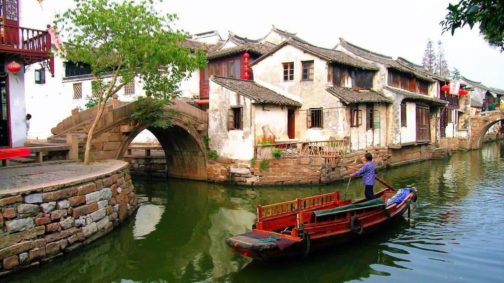 woman in ferry in canal in Suzhou, China