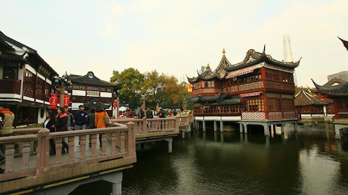 elevated Chinese architecture at a pond in Shanghai