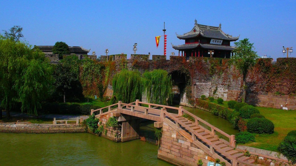 Show item 4 of 9. small gate underneath a water bridge in China