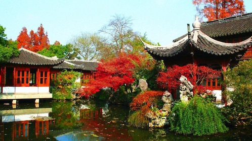 vibrant colored leaves along the pond in China