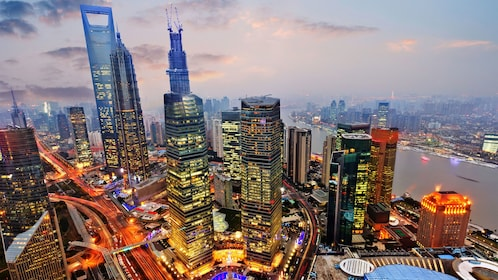 the brightly lit cityscape of Shanghai