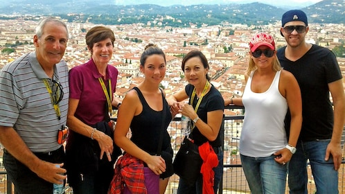 group posing in front of the city of Florence in Italy
