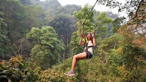 Woman on zip line in Thailand