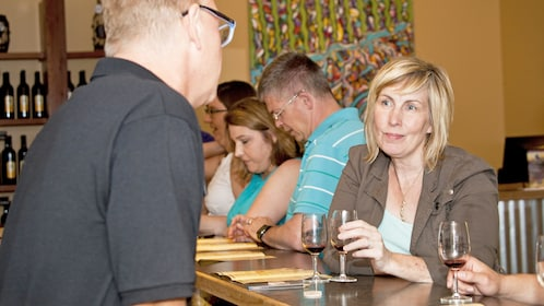 Woman enjoying her wine on the tour of Fox River Valley Wine Tasting Room Tour in Chicago