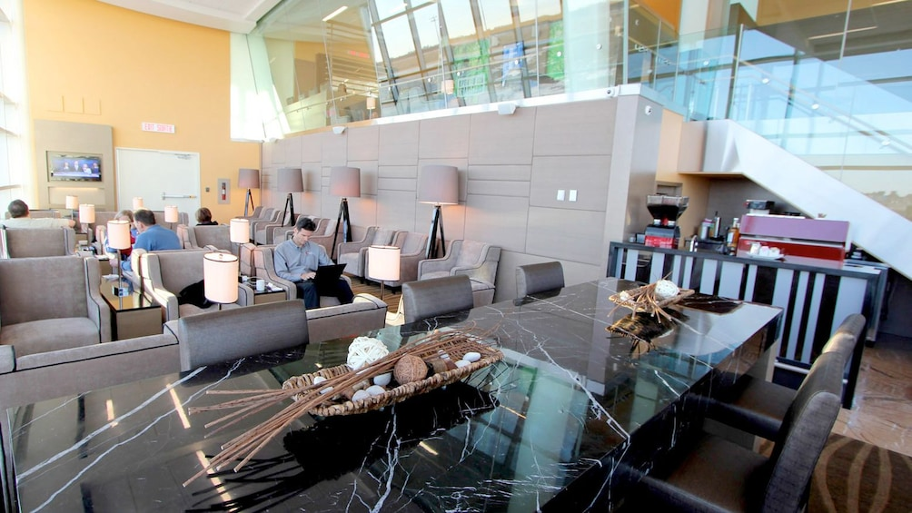Show item 1 of 5. Couch area inside the Plaza Premium Lounge at Edmonton International Airport