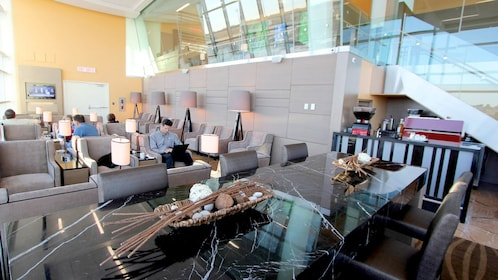Couch area inside the Plaza Premium Lounge at Edmonton International Airport