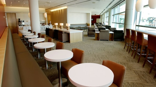 Table and seating area at the Plaza Premium Lounge at Toronto Pearson International Airport