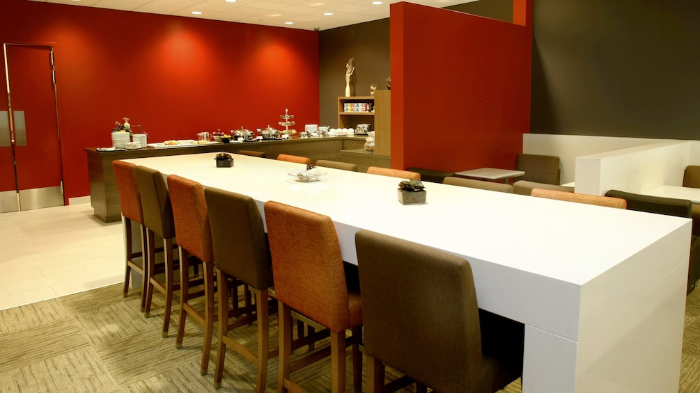 Show item 5 of 5. Dining area inside the Plaza Premium Lounge at Toronto Pearson International Airport