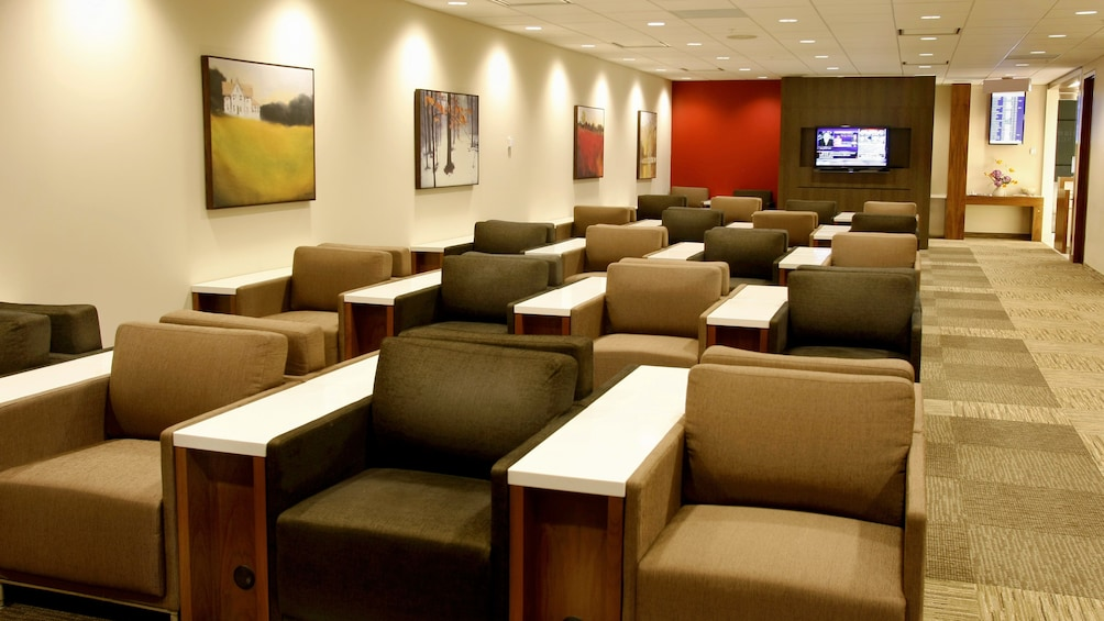 Show item 3 of 5. Depth view of the seating area inside the Plaza Premium Lounge at Toronto Pearson International Airport