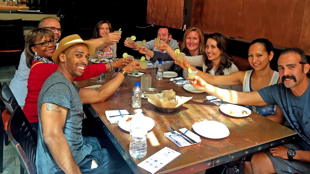 Group dining and drinking on the Original Downtown Food Tour by Taste Santa Barbara Food Tours